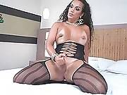 Stacked Latin Tranny Poses On Bed 2